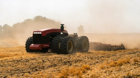 Autonomous tractor working in the field. Smart farming concept